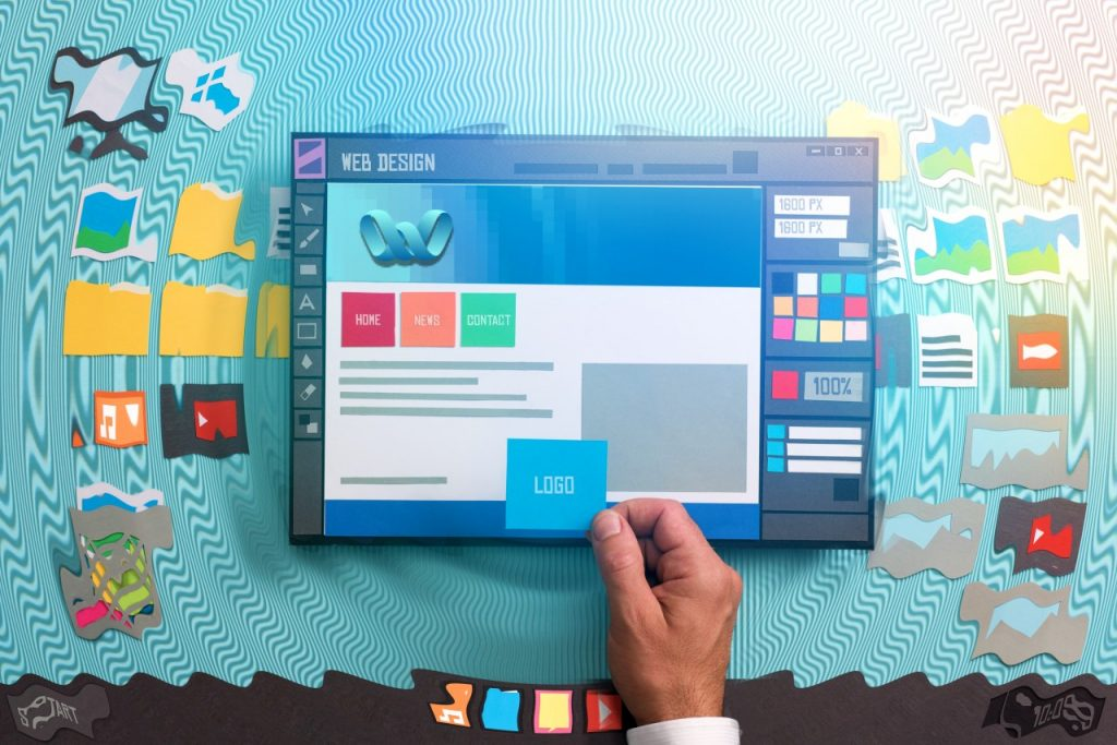 Web design in York - Weekend Web solutions man designing website layout with cute paper sizes